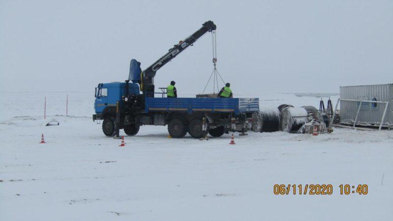Фото в процессе работы манипулятора HTMI-086A в Сургуте